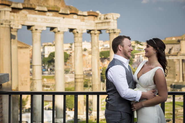 Bride and groom looking at each other while the Roman Forum is in the background