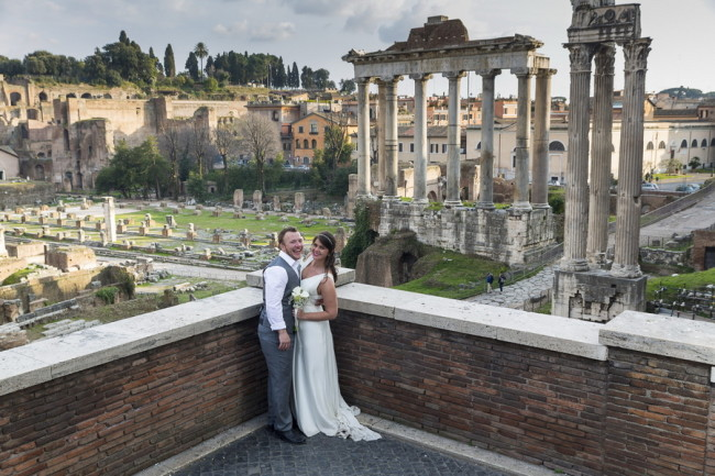Bride and groom standing in front of Roman Forum