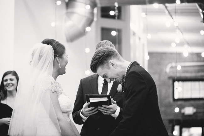 Bride and groom laughing during modern and whimsical wedding ceremony