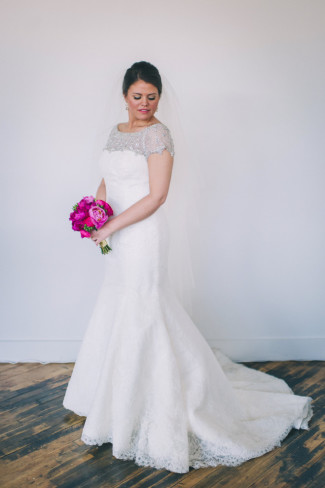 Bride wearing mermaid gown with train and illusion neckline