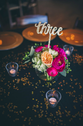 Gold sparkly table number for wedding reception