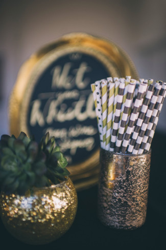 Gold Striped paper straws and gold round sparkly vase with a succulent plant