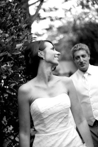 Bride wearing strapless gown looking back at groom who is following capture by Sherri Diteman Kaven