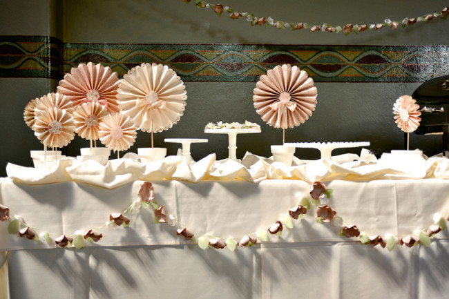 Wedding reception dessert table decorated with DIY paper pin wheels