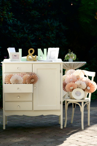 A dresser for a wedding guest book table