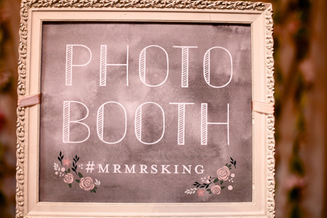 Chalkboard sign for photo booth and bride and groom's hashtag