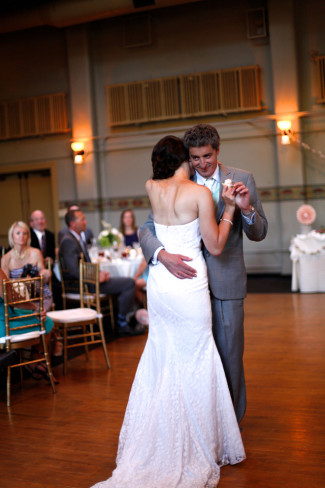Bride and groom dancing during wedding reception at McMenamins Kennedy School