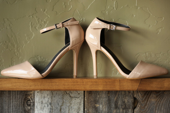 bridal shoes. Pair of nude pointy toe ankle strap pumps on shelf