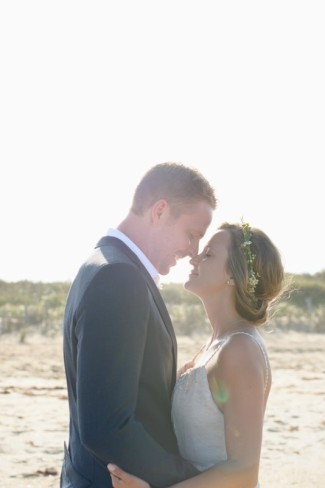 bride and groom nose to nose on beach for couple portraits taken by Neil GT Photography