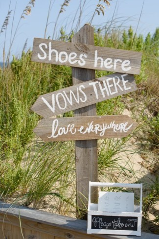 "Wooden sign directing guest. ""Shoes here, vows there, love everywhere"""