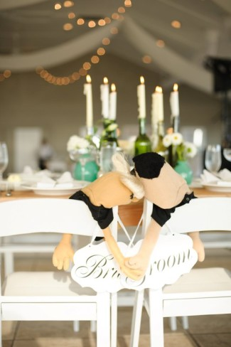 Bride and groom sign on back of their chairs