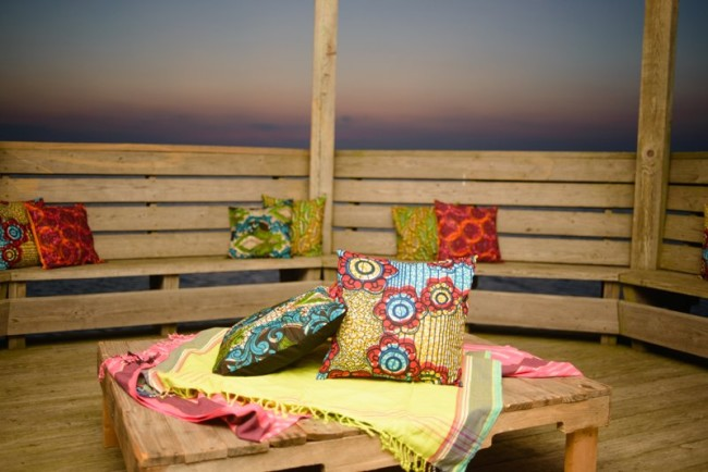 outdoor lounge area with brightly colored Kenya wraps and cushions
