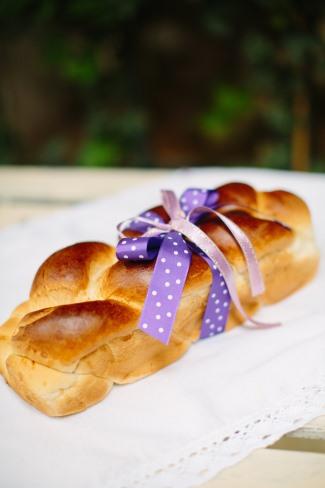 fresh bread wrapped in purple ribbon