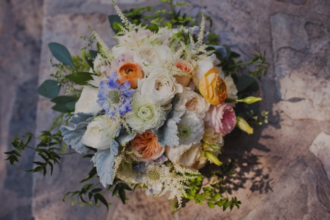 Bridal bouquet of blue hydrangeas, periwinkle thistle, white lisianthus, English garden roses, jasmine vine, seeded eucalyptus , dusty miller and ranunculas.