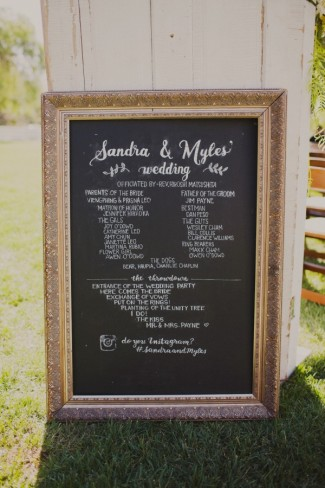 Gold frame chalkboard sign for wedding ceremony program