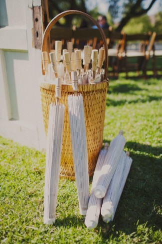White umbrellas for wedding ceremony guests