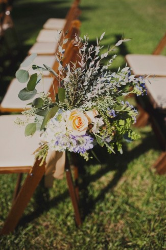 Ceremony chair decor with blue hydrangeas, periwinkle thistle, English garden roses, jasmine vine, seeded eucalyptus