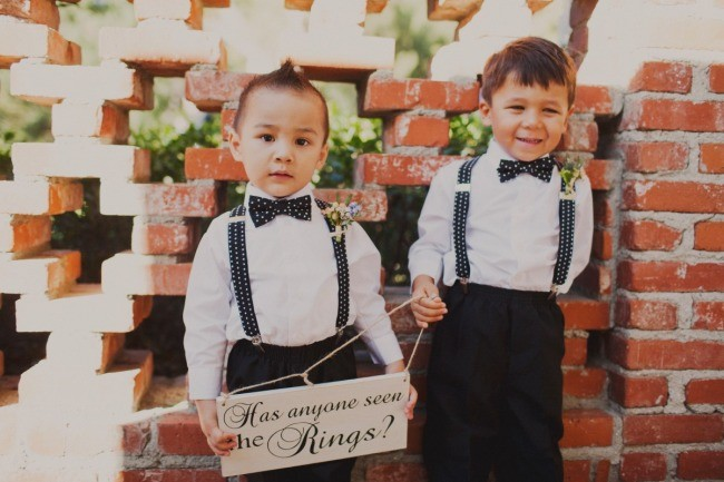 "Ring bearers holding a sign that says ""Has anyone seen the rings?"""
