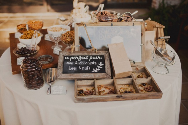 Wine chocolate, beer and nut table for wedding reception