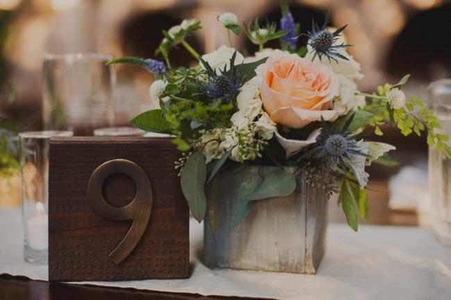 Wedding reception table number made from wooden block and gold number