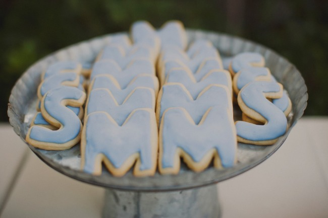 Blue cookies in the shape of the bride and grooms initials