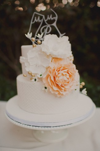 2 tier wedding cake with big white and beach flowers