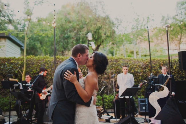 Bride and groom kissing and dancing at Hummingbird Nest Ranch wedding reception