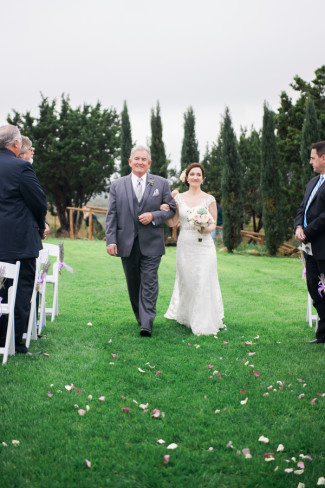 Bride walking down aisle in a Maggie Sottero gown with father at Rancho Mirando wedidng