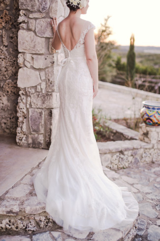 Bride standing on steps at Rancho Mirando wearing a Maggie Sottero gown