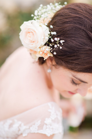 Bride with pink roses and baby's breath in her hair