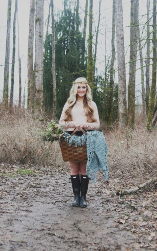 Styled bride in Washington forest carrying picnic basket with blanket