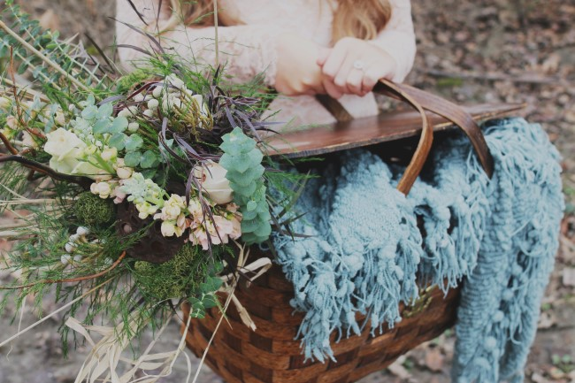 Girl carrying wood picnic basket with blue blanket and Green rustic bouquet created by Flowers by Korissa