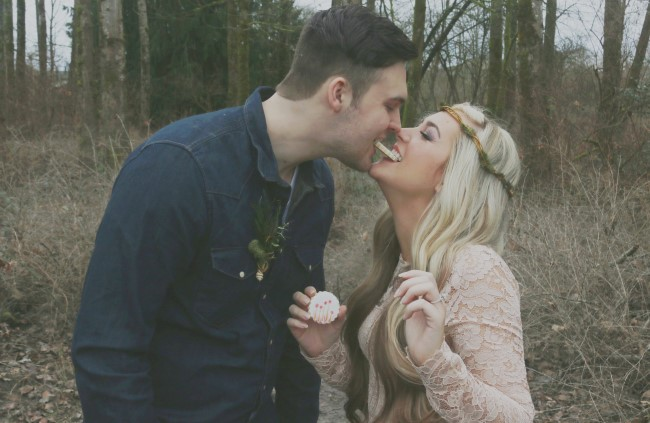 Couple eating a cookie created by Turquoise & Pink for rustic engagement shoot