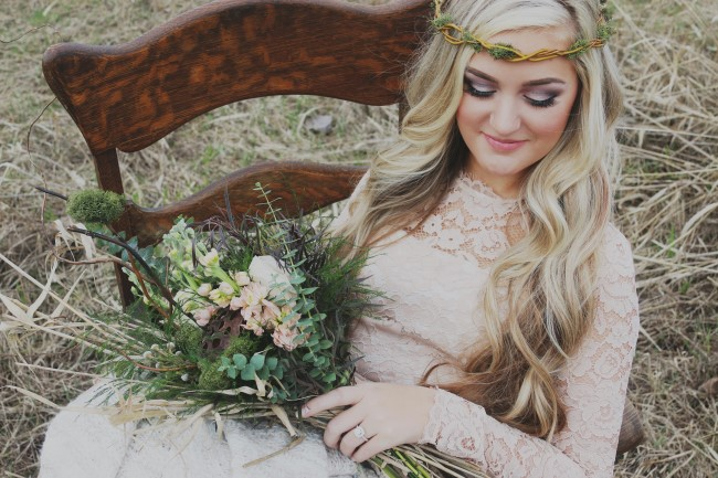 Bride sitting in a rocking chair with rustic bridal bouquet created by Flowers by Korissa