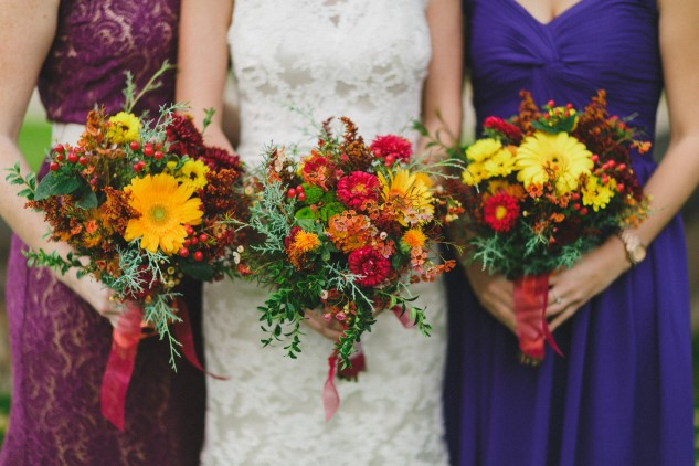 colorful orange, yellow, and red bridal bouquet