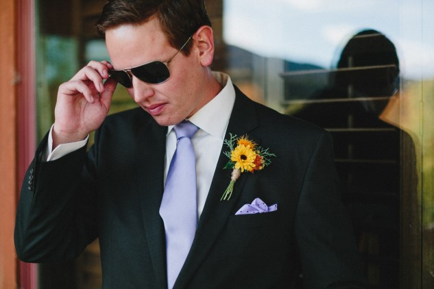 groom in sunglasses and periwinkle color necktie