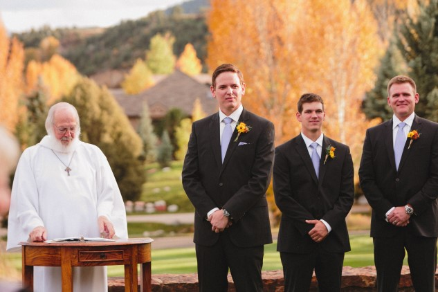 groom and groomsmen waiting with officiant