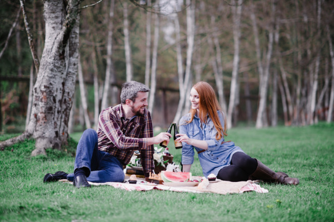 Couple having an outdoor picnic for engagement shoot