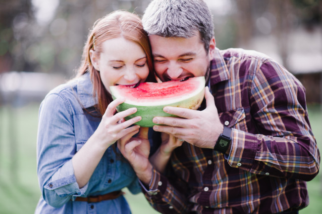 Couple eating a piece of water melon