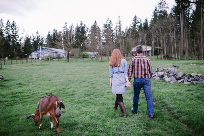 Engaged couple walking on the property of Left Foot Farm for engagement shoot