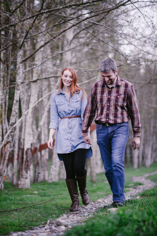 Couple walking hand in hand along a path for an outdoor engagement shoot captured by Barrie Anne Photography