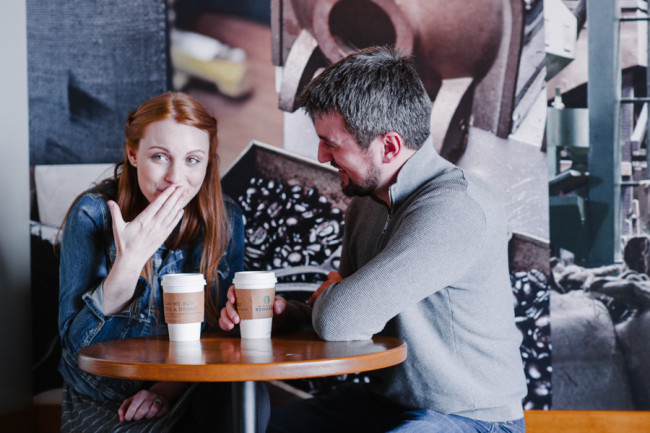 Couple sitting at Starbucks for engagement shoot photos