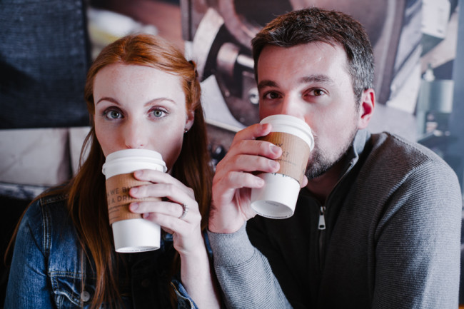 Engaged couple sipping coffee at starbucks