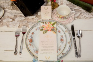Vintage china place setting for boho wedding reception