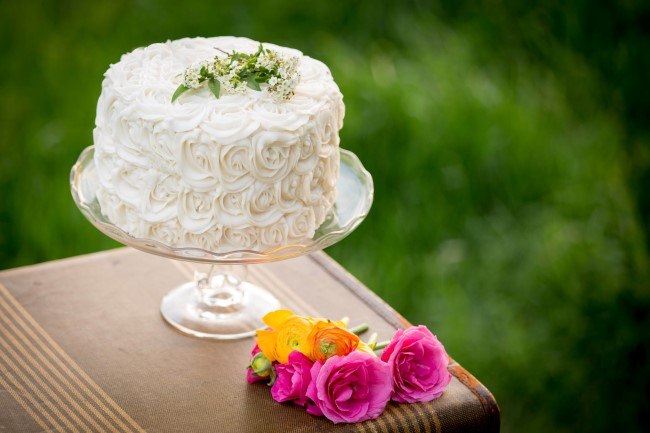 wedding cake with rossetts by Uncle Willie's Pies and Catering