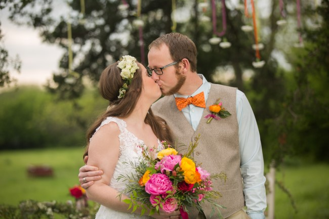 Bride and groom kissing in boho styled shoot captured by Justin Yoder Studios