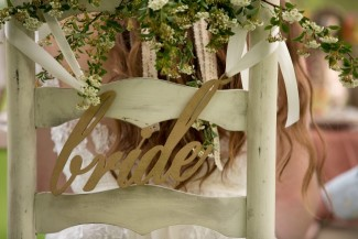 "Wooden chair sign that spells ""bride"""