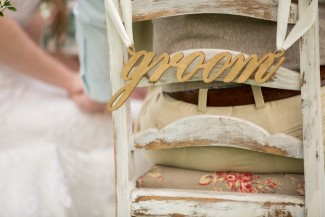 Wooden chair sign that spells groom