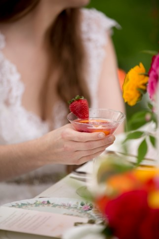 bride holding a martini with a strawberry