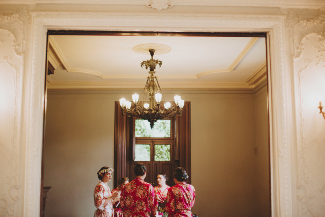 Bride with bridesmaids in bright colored robes getting ready at Cylburn Arboretum